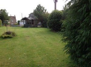 Looking down the length of the garden from front wall to summerhouse